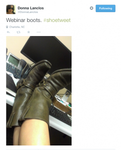 """Webinar boots. #shoetweet"" author's feet up on her desk in front of her computer"