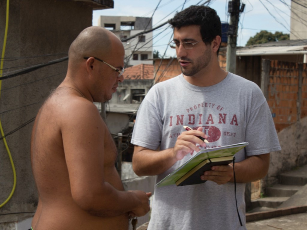 Interviewing in the favelas. Photo by Jeferson Louis.