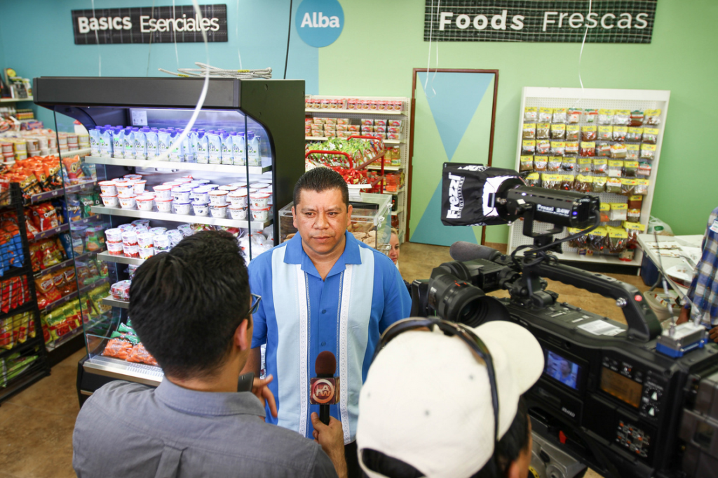 interviewing owner inside Alba