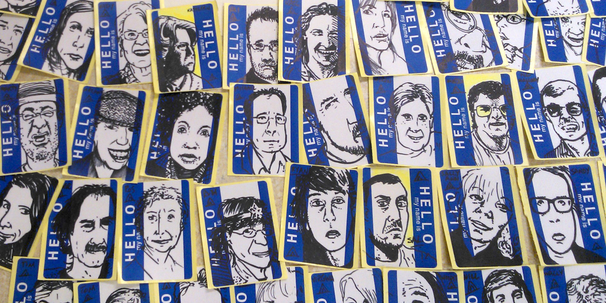 artwork by andres musta, faces drawn on name tags